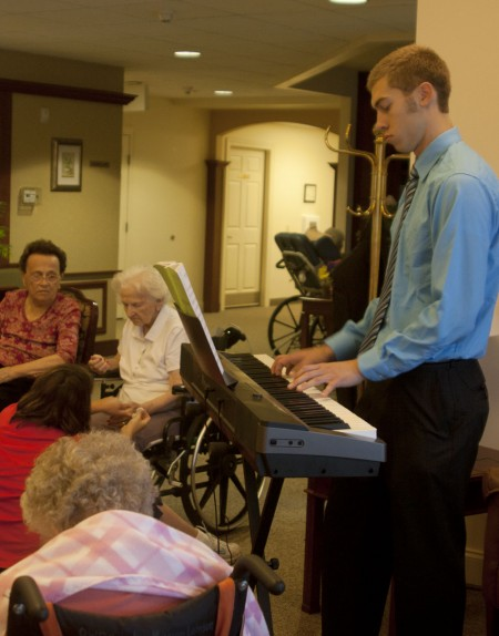 Music to Elderly Ears: Ferris State student Jordan Scott has been playing piano for elderly Big Rapids citizens. Jordan performs a large range of music selections at several assisted living facilities. Photo By: Kate Dupon | Photo Editor