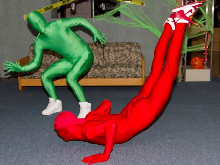 Halloween Festivities: Joe Nodge and Steve Jones sport green and red man suits recognizable from the TV show It's Always Sunny in Philadelphia. Photo By: Brock Copus   Photographer