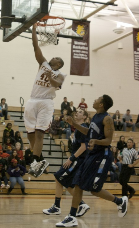 Beating Northwood: Justin Keenan dunks a ball during a game against Northwood on Dec. 11. The Bulldogs recently played Northwood on Jan. 15 and won 94-85. Photo By: Kate Dupon | Photo Editor