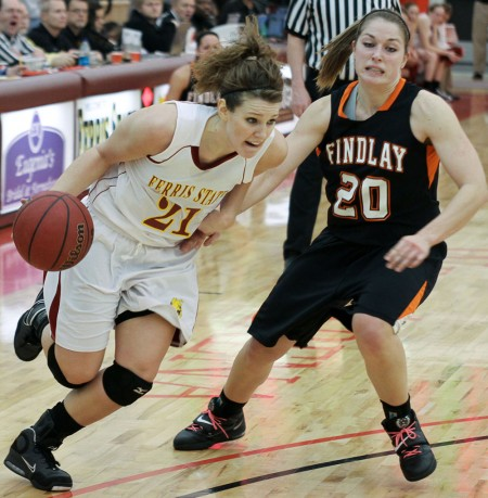 Defeated: Bulldog Junior Kelsey DeNoyelles, drives past a Findlay defender during a Feb. 19 game. The Bulldogs fell to Findlay 82-67. Photo By: Brock Copus | Photographer
