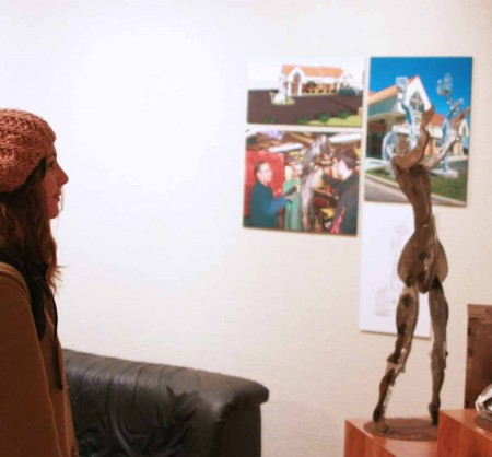 Metal Art: Ferris student Kaileen Shanahan enjoys the Rankin Art Gallery which is currently showing an Asethetic Engineering display. Some of the work are model size representations of artwork found around Big Rapids. Photo By: Kate Dupon | Photo Editor