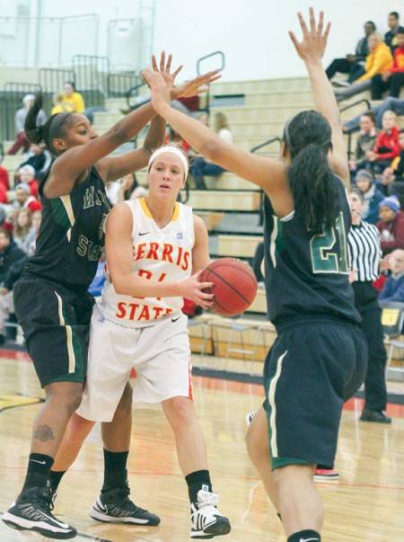 Double Teamed: Lady Bulldog Ashley Rando holds the ball away from Wayne State defenders. Ferris State would fall 81-68. Photo By: Brock Copus   Multimedia Editor