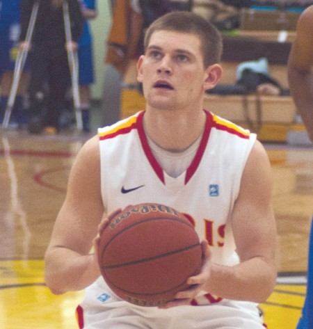 Intense Concentration: Ferris guard Drew Lehman prepares to put up a free throw against Lake Superior State. Lehman has started all 23 games this season while putting up 12.7 points per game. Photo By: Tori Thomas | Photographer