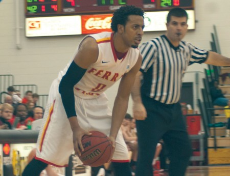 Planning a Move: Ferris guard Kenny Brown holds the ball against Saginaw Valley State. Brown made 17 points in the Bulldogs' final home game loss against the Cardinals, 75-67. Photo By: Tori Thomas | Photographer