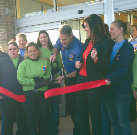 Manager Dean Quiggle cuts the ribbon marking the opening of the new Aldi grocery store in Big Rapids, located at 21481 Perry Ave. The store offers a variety of grocery products at a low price. Photo By: Taylor Hooper   News Writer