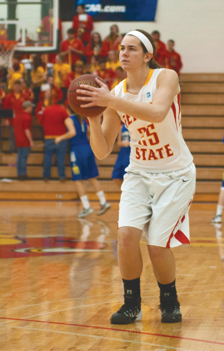 Freshman Kendra Enszer warms up before the 2nd half of the game against Lake Superior State, which Ferris won 74-71. Enszer is a Big Rapids native and has had her eyes set on playing basketball for Ferris for years. Photo By: Tori Thomas   Photographer
