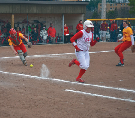 Ferris freshman catcher Casey Bias reaches to field a bunt against Saginaw Valley State in one of the few home games Ferris has been able to play this spring. Photo By: Corey Saladin | Interim Photographer