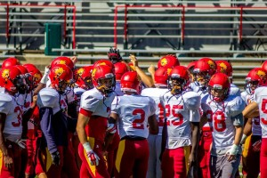 Ferris State football's defense gathers in the middle of the field following  a team scrimmage  during one of the Bulldogs padded practices.