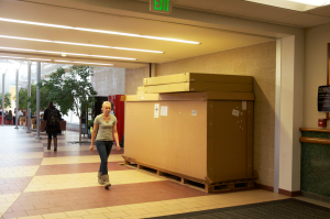 Marketing junior Ashley Soller walks by the box that has been mysteriously placed inside the IRC, where it has been since the first semester, apparently untouched.