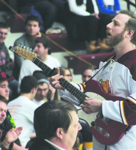Bulldog fans share a musical moment with a special guest during a media timeout.