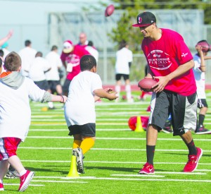Kids participate in a group camp with the San Francisco 49er's, quarterback Colin Kaepernick, in Pacifica, California.